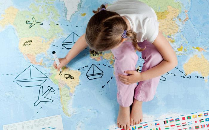 girl drawing on map uk school holidays