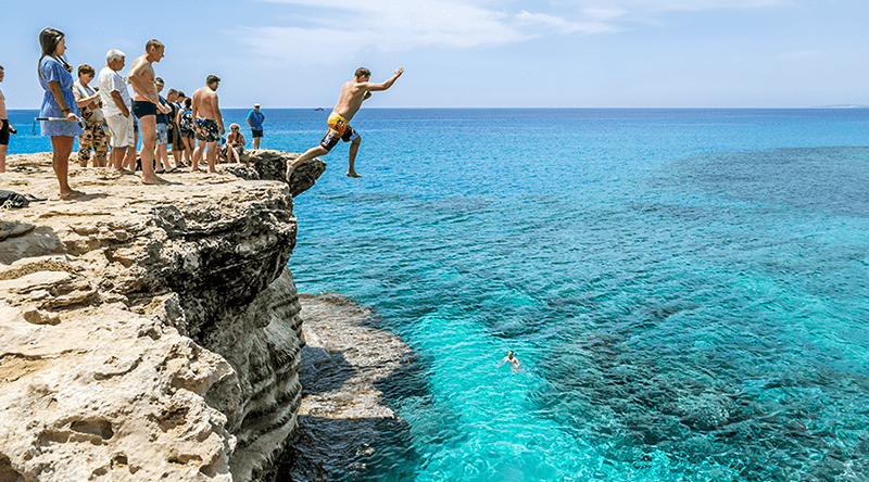 Cliff diving at Cape Greco