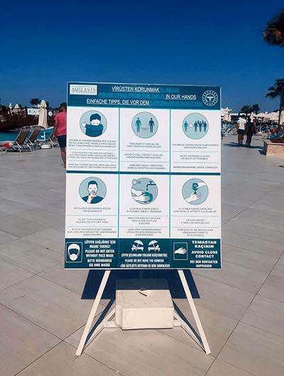 Beach sign encouraging social distancing
